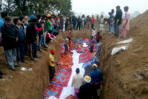 Villagers preparing ground to bury bodies of cows found slaughtered in Nihal Singh Wala on Tuesday.