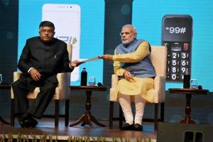 Prime Minister Narendra Modi and Union Minister IT and communications, Ravi Shanker Prasad at the launch of a new mobile app