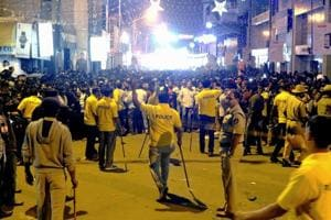 Police personnel attempt to manage crowds during New Year