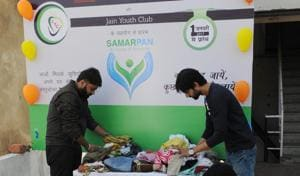 Samarpan ki Deewar at Koh-e-Fiza where people donate their belongings for the needy.