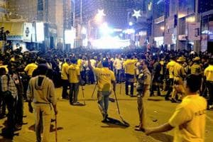 Policemen attempt to manage crowds during New Year