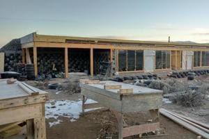 All aboard the 'Earthship': Living in a plush bungalow without power, water supply