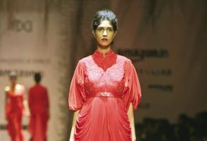Crimson is colour of choice in silhouettes ranging from  jackets to gowns and capes this season
