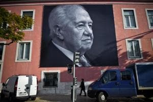 A towering figure: Big pictures of the historic socialist leader and former Portuguese President Mario Soares are displayed on a facade of the Portuguese Socialist party headquarters in Lisbon on Sunday, a day after his death.