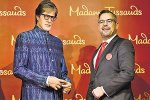 New Opening Europe and Emerging Markets director Marcel Kloos (R) unveiled actor Amitabh Bachchan's wax figure at Delhi's Shangri-La Hotel on Thursday.