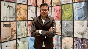 Artist Jitish Kallat with his work, The Cry of the Gland (2009), a study of shirt pockets and their contents.