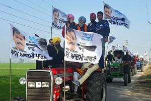 Aam Aadmi Party candidate from Dakha constituency HS Phoolka campaigning with his supporters on a tractor at Khandoor village in Ludhiana on Friday.