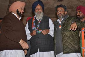 Punjab Congress chief Captain Amarinder Singh welcoming a SAD leader into the party fold in Talwandi Sabo on Sunday.