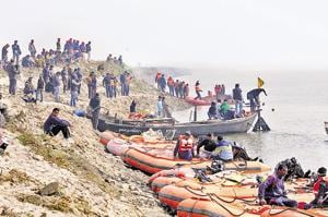 NDRF jawans undertake rescue operation at the Gandhi Ghat in Patna.