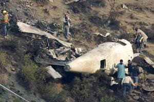 Bodies of crew of crashed Pakistani airliner to be exhumed for tests