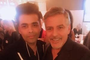 Karan Johar poses with George Clooney at Davos