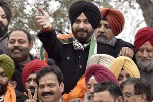 Navjot Singh Sidhu with other Congress leaders during a road show in Amritsar on Tuesday.