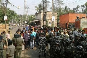 Police personnel at Bhangar after a clash with villagers over power grid project in South 24 Parganas.