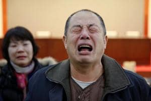 MH370 search op suspended: Chinese families lash out, call it 'wrong,...