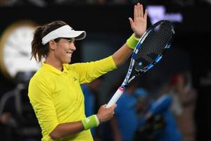 Garbine Muguruza defeats Samantha Crawford to reach Australian Open...