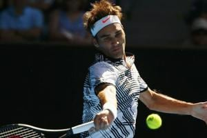 Roger Federer made to work hard by American qualifier in Australian...