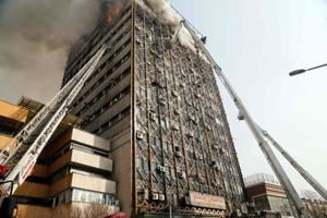 At least 38 firefighters hurt as blazing Tehran building collapses:...