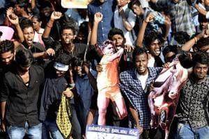 Students at Kamarajar Salai near Chennai's Marina Beach protesting on Wednesday to lift the ban on Jallikattu and demanding a ban be imposed on PETA.
