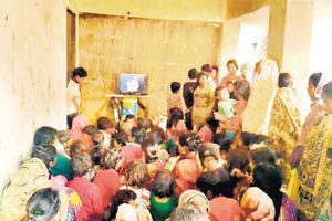 Women watching TV at Naubatpur village near Patna.