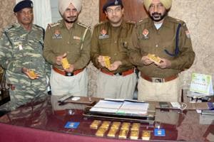 Police officials displaying the gold bars in Ludhiana on Friday.