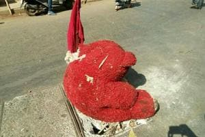 Teddy bear stands guard over broken manhole cover in Bhayander