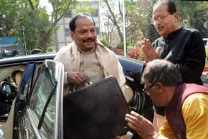 Chief Minister Raghubar Das coming with suitcase containing the Jharkhand Budget -2017-18 to present before the house during  on Monday