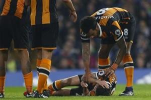 Hull City's Ryan Mason undergoes surgery after fracturing skull in...