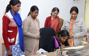 Rajasthan WCD minister Anita Bhadel with Garima Award winners who were made minister for a day, at her s office in Jaipur on Tuesday.