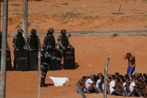 Riot policemen do a head count of inmates during an uprising at Alcacuz prison in Natal, Rio Grande do Norte state, Brazil, January 24.