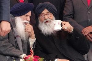 Punjab chief minister Parkash Singh Badal with agriculture minister Tota Singh during a rally in Moga on Tuesday.