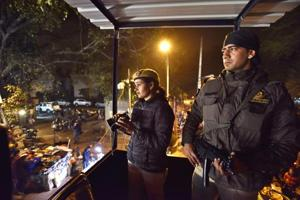 Delhi Police officials guard Sarojini Nagar market on the eve of Republic Day.