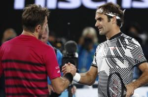 Roger Federer, right, is congratulated by Swiss compatriot Stan Wawrinka, after winning their semifinal at the Australian Open tennis championships in Melbourne on Thursday.