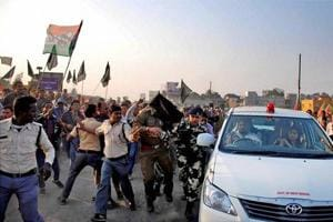 TMC activists show black flag and try to attack the car of union minister of state Babul Supriyo in Asansol in Burdwan district of West Bengal on Monday.