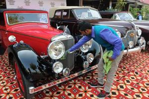 A man cleans a 1936 model Alvis Speed 20 vintage car in Sector 29 on Monday. As many as 14 vintage cars from Gurgaon will feature in the three-day event starting February 17.
