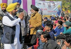 Aam Aadmi Party candidate Narinder Singh Shergill interacting with people during a rally at Dussehra Ground, Phase 8, SASNagar, on Wednesday.