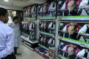 People are watch the live telecast of the Union Budget 2017, at a shop in Esplanade in Kolkata on Wednesday.