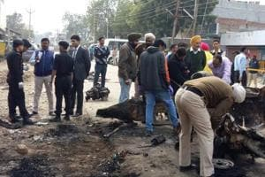 A team of National Security Guards (NSG) collecting samples at the site of bomb blast in Maur on Thursday.