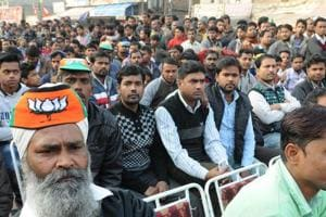 Migrant labourers among the crowd at a BJP rally in Ludhiana on Tuesday.