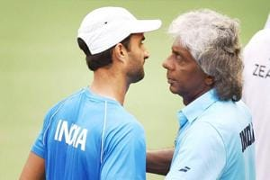Yuki Bhambri greeted by the India's Davis Cup non-playing captain Anand Amritraj after winning a Davis cup singles rubber against New Zealand.