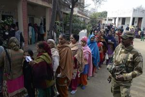 Voters line up to cast their ballots in assembly elections at a polling station on the outskirts of Jalandhar.