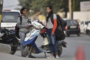 Yasmeen (L) and Pooja (R) during duty hours near the Garden of Five Senses in Delhi.