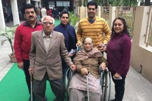 Rakesh Sachdev with his family outside a polling station in Ludhiana on Saturday.