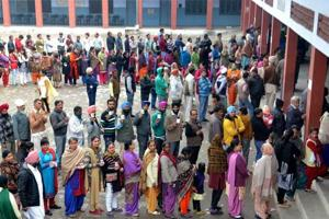 Jalandhar: People standing in queues to cast their votes at a polling station in Jalandhar on Saturday.