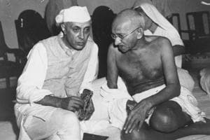 Mahatma Gandhi (right) and Jawaharlal Nehru  in conversation at the All-India Congress committee meeting.  In December 1946, as Gandhi walked across East Bengal's shattered villages, Nehru and Jinnah flew to London together to find a solution to the great discord between the Congress and the Muslim League on the scope of the new Constitution.