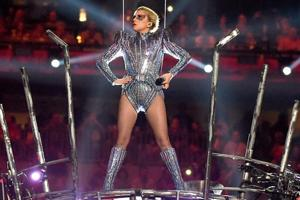 Lady Gaga performs onstage during the Super Bowl LI half-time show at NRG Stadium in Houston, Texas. During the show, the artist made subtle criticism of president Donald Trump's policies.