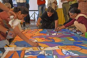 Outlined on the 6-metre x 1.80-metre canvas in intricate detail were the heritage buildings of the art district, the new equestrian statue, the ocean in the distance. And 30 eager participants clustered around it for two hours at the Artists' Centre art gallery, painting in the watercolours.
