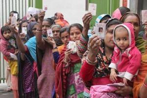 Migrant labourers in a queue to vote in Ludhiana on Saturday, February 4.