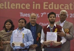 Delhi education minister Manish Sisodia (centre) with students at the Excellence in Education Awards ceremony in New Delhi
