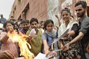 JNUSU president Kanhaiya Kumar, Umar Khalid, Anirban Bhattacharya and Shehla Rashid Shora protest in front of the administrative block in New Delhi.