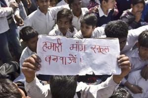 Students of a government school in Shahbad Dairy at a protest on Friday, demanding new school building. The school building was declared unsafe by the government last year.
